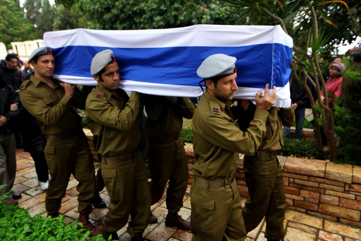 Israeli soldiers carry the coffin of Israeli reserve soldier Boris Yarmolnik, 28, during a funeral at the military cemetery in Netanya, Israel, 23 November 2012. Boris Yarmolnik reportedly died from injuries caused by rocket fire from the Gaza Strip. Palestinians and Israelis on both sides of the Gaza border try to resume everyday life since 22 November, the day after a ceasefire ended eight days of cross-border violence.  EPA/ABIR SULTAN