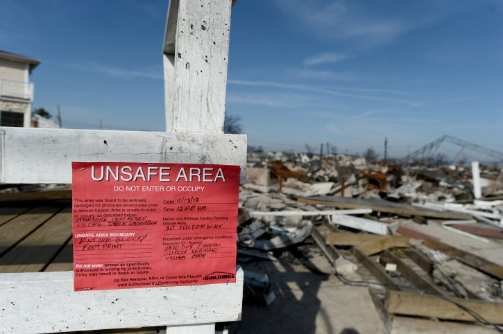 FILE - A Department of Buildings sign condemning a burned out property  as the area continues to deal with the aftermath of Hurricane Sandy in Breezy Point, New York, USA, 23 November 2012. EPA