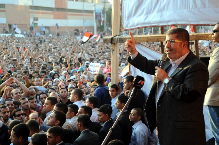 A handout picture released by the Egyptian Presidency shows Egyptian President Mohamed Morsi (R) speaking to his supporters, as he delivers a speech, next to the Presidential Palace in Cairo, Egypt, 23 November 2012. Thousands of Pro-Government prostesters gathered near the Presidential Palace as opposition planned a mass rally to protest constitutional changes ordered by the Islamist President Morsi. Egyptian President Morsi said on 23 November that a decree granting him sweeping powers was not designed to 'settle scores' with the opposition, but to ensure national stability.  EPA