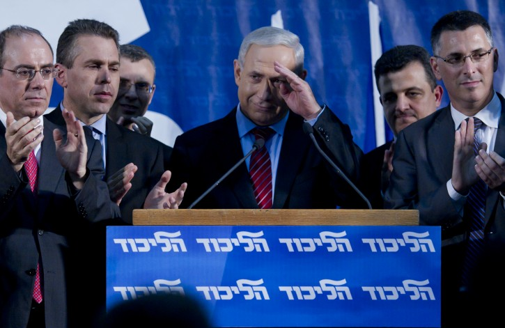 Israeli Prime Minister Benjamin Netanyahu salutes members of his Likud party at the conclusion of their primary, after votes are counted and a new parliamentary (Knesset) list is announced, in Tel Aviv, Israel, early 27 November 2012. The Likud dropped several of its more moderate old time members in exchange for younger more right-wing members.  EPA/JIM HOLLANDER