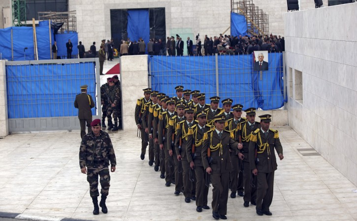 Palestinian soldiers leave the mausoleum of the late Palestinian President and PLO Chairman Yasser Arafat in the West Bank town of Ramallah, 27 November 2012. The body of former Palestinian president Yasser Arafat was exhumed Tuesday, part of efforts by an international team investigating claims that he had died of poisoning, Voice of Palestine Radio reported. French, Swiss and Russian experts, who flew to Ramallah to conduct the probe, were taking samples. The body of the former president is to be re-interred later in the day in a military ceremony. The results of the tests are expected to be known within days, or by the end of the year at the latest. Arafat died at the age of 75 in a French hospital on November 11, 2004. Medical records show he died of a brain hemorrhage, caused by a bowel infection. Some Palestinians blame Israel for his death, a claim Israel has strenuously denied.  EPA/ATEF SAFADI