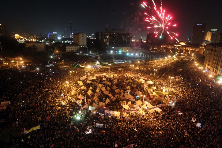 A general view shows Egyptian protesters firing fireworks as they are demonstrating against the President Mohamed Morsi decree, in Tahrir Square, Cairo, Egypt, 27 November 2012. Tens of Thousands of opponents of President Mohamed Morsi protested across Egypt on 27 November, stepping up pressure on the Islamist leader to back down on his decree granting himself sweeping powers. Protesters in Cairo converged on Tahrir Square where a sit-in began on 23 November, after Morsi signed a decree making all his decisions and laws immune from legal challenge.  EPA/MOHAMED ADEL