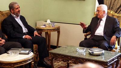 FILE -  A handout photograph released by the Hamas Press Office shows Palestinian President Mahmoud Abbas (R) speaking with Hamas leader Khaled Meshaal (L) in Cairo, Egypt, 24 November 2011.  EPA