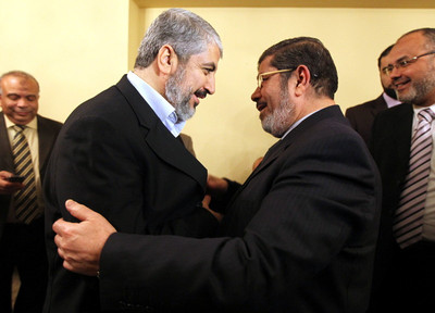 FILE - A handout photograph released by the Hamas Press Office showsLeaders of the newly formed Freedom and Justice Party, President Mohammed Morsi  (R)  and leader of the Muslim Brotherhood greeting Palestinian Hamas leader Khaled Meshaal in Cairo, Egypt, 21 January 2012  .  EPA/MOHAMED HAMS