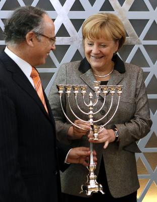File -  German Chancellor Angela Merkel receives a Hanukkah menorah from the Council's President Dieter Graumann (L) after her arrival at the council in Frankfurt am Main, Germany, 25 November 2012.  EPA