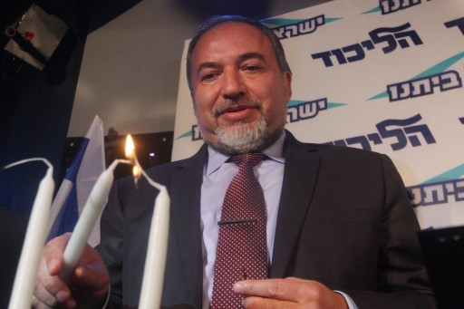 Israel's Foreign Minister Avigdor Liberman lights a Chanucka candle as he speaks to party members in Tel Aviv on December 13, 2012. Photo by Roni Schutzer/FLASH90