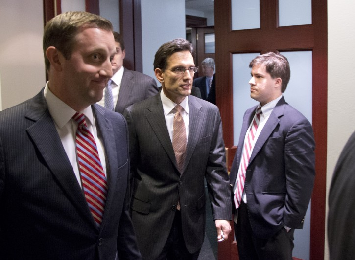 Majority Leader Eric Cantor from Virginia, center, departs after a House Republicans meeting on Capitol Hill, Thursday, Dec. 20, 2012 in Washington.(AP Photo/Alex Brandon)