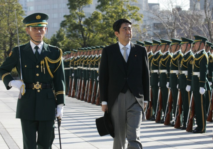 In this Jan. 9, 2007 file photo, Japanese Prime Minister Shinzo Abe, right, reviews an honor guard in a ceremony at the Defense Ministry. (AP Photo/Katsumi Kasahara, File)