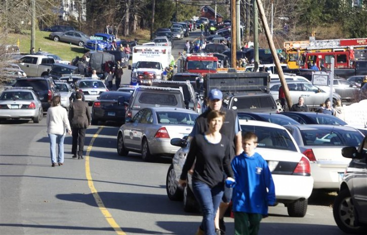 Parents pick-up their children near Sandy Hook Elementary School in Newtown, Connecticut, December 14, 2012. A shooter opened fire at the elementary school in Newtown, Connecticut, on Friday, killing several people including children, the Hartford Courant newspaper reported. REUTERS/Michelle McLoughlin