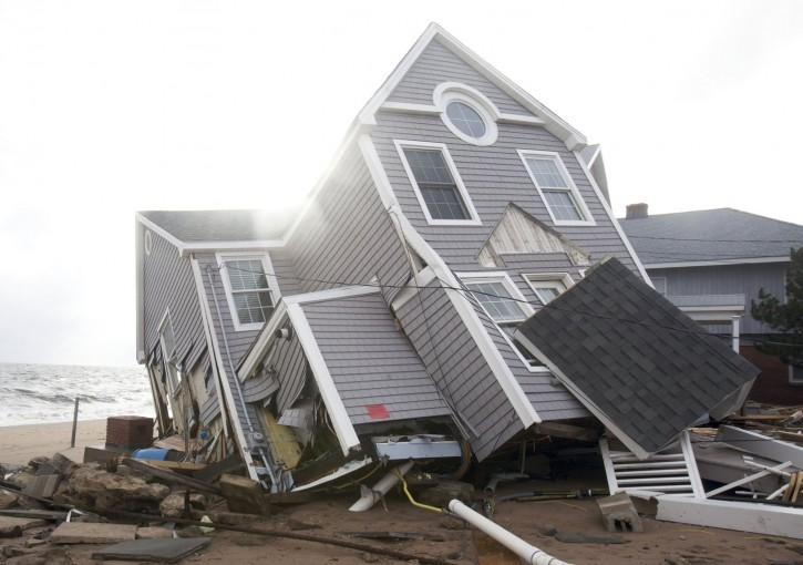 One of many homes badly damaged by Hurricane Sandy. REUTERS/Michelle McLoughlin