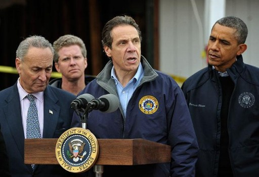 Sen. Chuck Schumer, Housing Secretary Shaun Donovan and President Obama (l. to r.) listen as Gov. Andrew Cuomo speaks in Cedar Grove, Staten Island, during a Nov. 15 visit to survey damage from Hurricane Sandy.  AP FILE