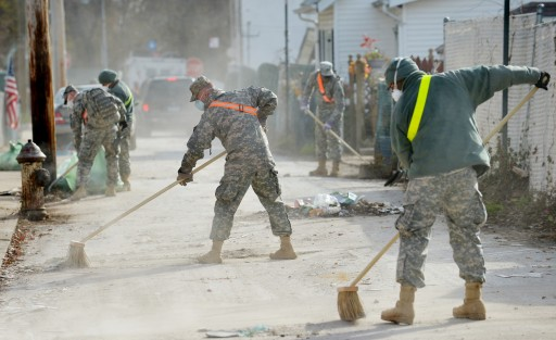 FILE - National Guard troops work on cleaning a street as people continue to try and recover from the aftermath of Hurricane Sandy in the New Dorp neighborhood of Staten Island, New York, USA, 15 November 2012. EPA