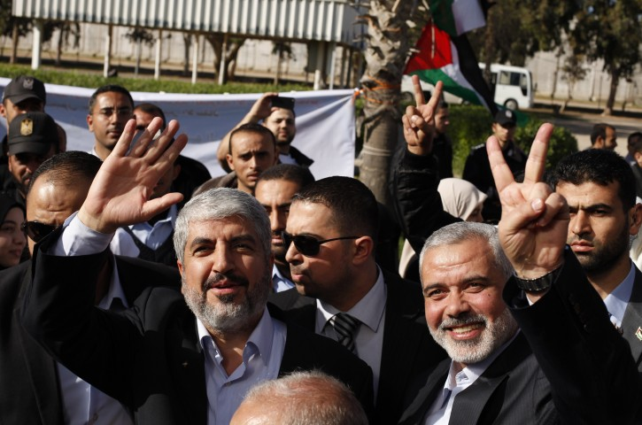 Hamas chief Khaled Meshaal (L) waves as he stands next to senior Hamas leader Ismail Haniyeh upon Meshaal's arrival at Rafah crossing in the southern Gaza Strip, 07 December 2012. EPA/SUHAIB SALEM / POOL