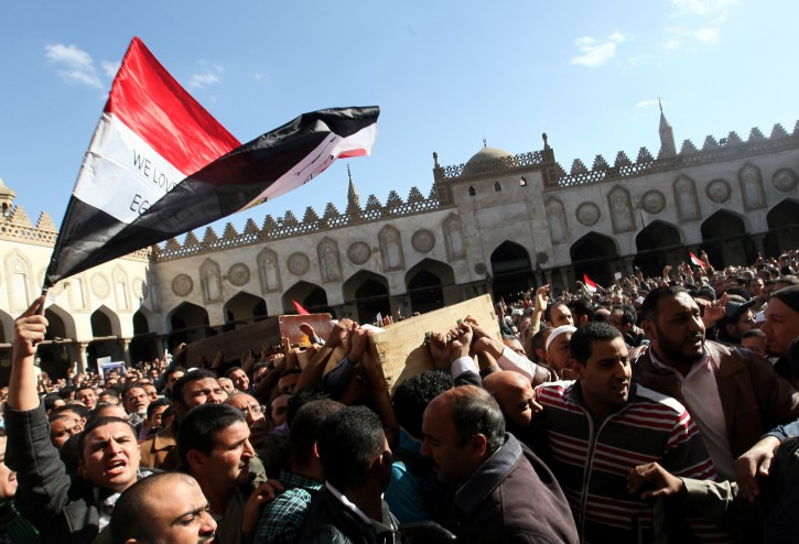 Egyptian supporters of Muslim Brotherhood carry the coffins of members of the group who were killed in clashes with Egyptian opposition protesters, during their funeral from Al-Azhar mosque, in Cairo, Egypt, 07 December 2012. EPA/KHALED ELFIQI