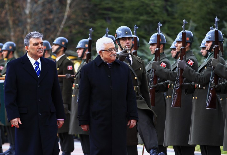 Turkish President Abdullah Gul (L) and Palestinian President Mahmoud Abbas (2-L) review the honor guard during a welcoming ceremony in Ankara, Turkey, 11 December 2012. Abbas is in Turkey for a three- day visit. EPA/MURAT KAYNAK/ANADOLU AGENCY