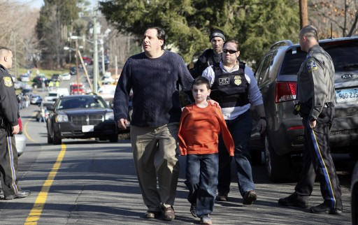 A parent and a child walk away from the Sandy Hook Elementary School following a shooting inside the school in Newtown, Connecticut, USA 14 December 2012.  EPA