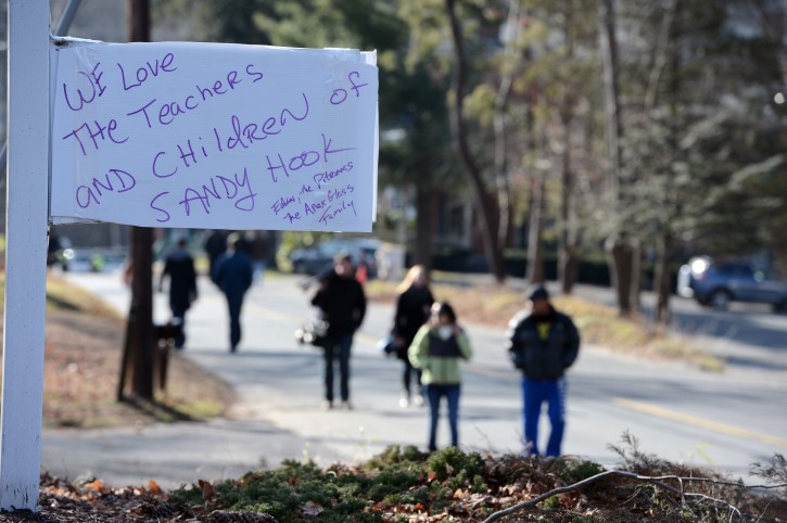 A view of a sign down the street from  memorial near Sandy Hook Elementary School following a shooting there on 14 December, that left at least 28 people dead, 20 of them young children, in Newtown, Connecticut, USA, 15 December 2012  EPA/ANDREW GOMBERT