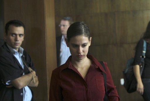 Anat Kamm (C) is seen inside a courtroom in Tel Aviv District Court October 30, 2011. An Israeli court sentenced Kamm, a former soldier, to four and a half years in prison on Sunday for leaking classified military documents to a newspaper, which later reported allegations of a policy to assassinate Palestinian militants. REUTERS/Ronen Zvulun