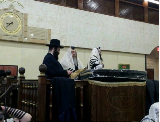 In this Dec. 11 2012 photos Zigelman in Shul reciting The Gomel Blessing at the Torah in an unidentified Borough Park synagogue. Photo: Courtesy