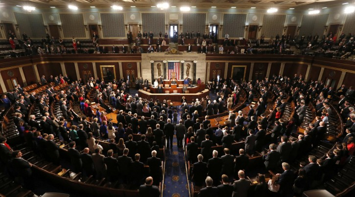 Members of the 113th Congress bow their heads in prayer as they convene in the Capitol in Washington January 3, 2013. REUTERS/Kevin Lamarque