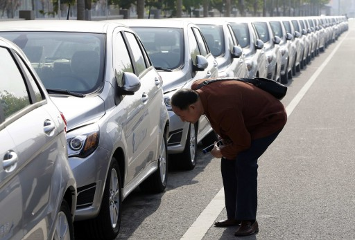 A visitor looks at a Beiqi E150EV car. REUTERS/Jason Lee/Files