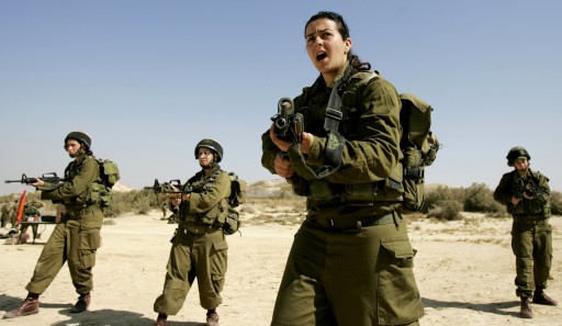 File photo of Israeli platoon commander Racheli Levantal (2nd R) of the Karakal ground Battalion, made up of male and female combat soldiers, shouts instructions during a training session at a military base in southern Israel. REUTERS/Eliana Aponte/Files