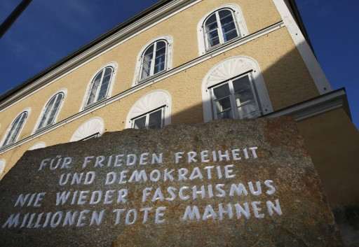 "A stone against the backdrop of the house in which Adolf Hitler w as born, with the inscription ""For peace, freedom and democracy, never again fascism, millions of dead are a warning"", in the northern Austrian city of Braunau am Inn, September 24, 2012. — Reuters pic"