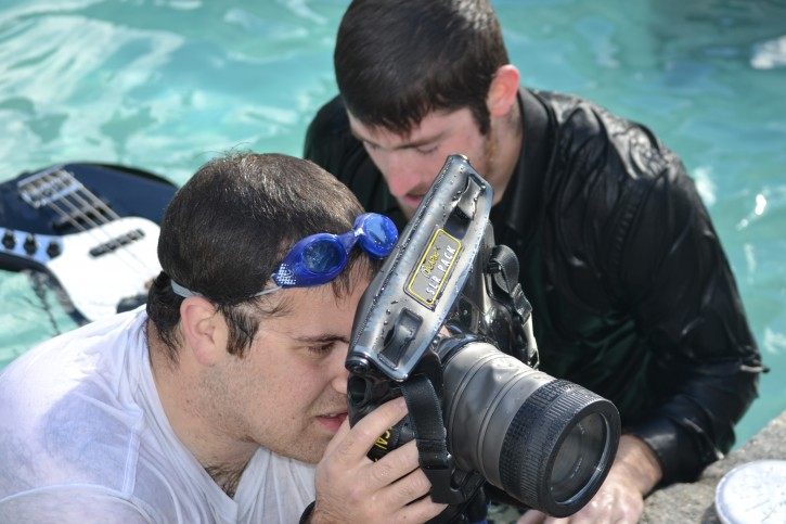 Moshe Bree going over some of the shots, through his underwater casing