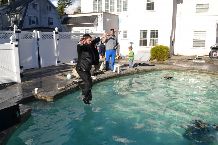 In this October 10, 2012 photo Singer Benny Friedman mid jump for the big dive scene for the video Maaleh Ani. The shoot took place in Waterbury, Connecticut. This jump was redone about ten times.