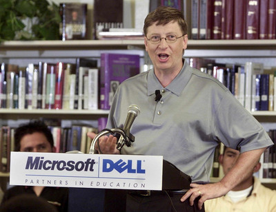 FILE -  Bill Gates, Chairman and Chief Software Architect of Microsoft, talks to students and reporters at Booker T. Washington High School in Miami, 09 July 2001.  EPA