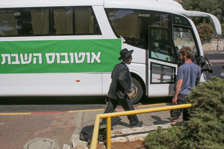 File photo of Meretz party activists prepare to ride Meretz-sponsored bus, termed Meretz