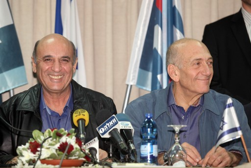 Chairman of Kadima party, Shaul Mofaz (L) and former Prime Minister Ehud Olmert take part at a conference Tuesday night in Kfar Maccabiah in Ramat Gan. January 01, 2013. Photo by Gideon Markowicz/Flash90