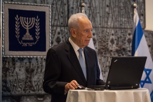File photo of Israeli president Shimon Peres launching a Facebook page that calls youths to vote. Jan. 06, 2012. Photo by Uri Lenz/FLASH90