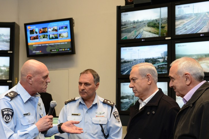 Israeli Prime Minister Benjamin Netanyahu (2nd R), Internal Security Minister Yitzhak Aharonovitch (R), Police Commissioner Yohanan Danino (2nd L) and Major General Bruno Stein (L), head of the Israel Police's traffic division during a visit at The National Traffic Police headquarters in central Israel. January 09, 2013. Photo by Kobi Gideon / GPO/FLASH90