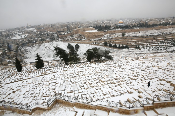 View of the Jewish cemetery and Dome of the Rock in Jerusalem's Old City seen from the Mount of Olives on a snowy winter day. January 10, 2013. Photo by Nati Shohat/FLASH90