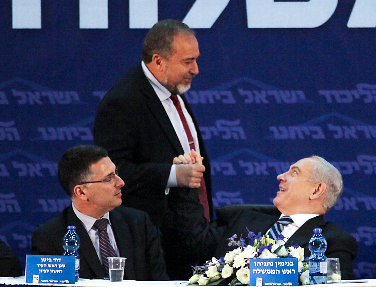 Israel's Prime Minister and leader of the Likud party Benjamin Netanyahu (R), leader of the Israel Beiteinu party Avigdor Liberman (C) and Minister of Education Gideon Sa'ar present their joint campaign prior to the Israeli elections, in Rishon LeZion on January 10, 2013. Photo by Gideon Markowicz/Flas90