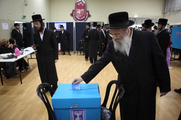 Ultra Orthodox Jewish men cast their votes for in the Israeli general elections for the 19th parliament, in the orthodox town of Bnei Brak. January 22 2013. Photo by Yaakov Naumi/Flash90
