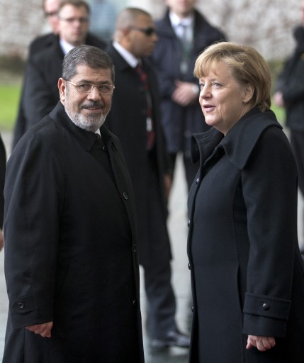 German Chancellor Angela Merkel, right, welcomes the President of Egypt Mohammed Morsi, left, with for a meeting at the chancellery in Berlin, Germany, Wednesday, Jan. 30, 2013. (AP Photo/Michael Sohn)