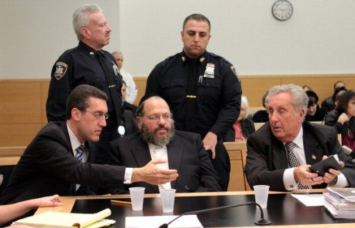 Nechemya Weberman (center)at State Supreme Court in Brooklyn after being found guilty of 59 counts of sexual abuse. L-R: Defense Attorney Michael Farkas, Nechemya Weberman, defense attorney George Farkas.(Photo By: Jesse Ward/NY Daily News via Getty Images-VINnews.com)