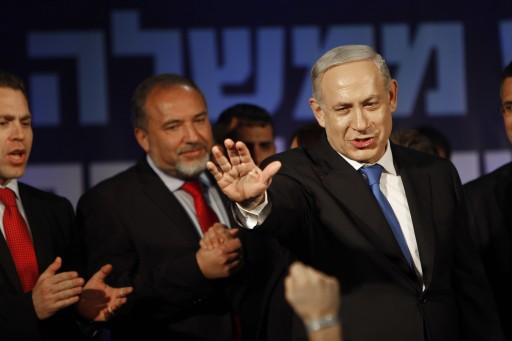 Israel's Prime Minister Benjamin Netanyahu, right, and former Foreign Minister Avigdor Lieberman greet their supporters in Tel Aviv, Israel, Wednesday, Jan. 23, 2013. (AP Photo/Oded Balilty)