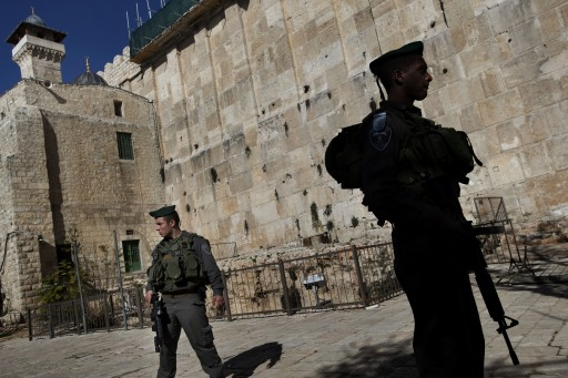 Israeli border police stand guard while waiting for the arrival of former Foreign Minister Avigdor Lieberman on the site known to Jews as the Tomb of the Patriarchs, and to Muslims as the Ibrahimi Mosque, in the West Bank city of Hebron, Monday, Jan. 14, 2013. (AP Photo/Bernat Armangue)