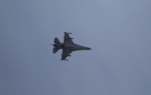 In this Nov. 18, 2012 file photograph, an Israeli F-16 jet fighter flies near the city of Ashdod, Israel. (AP Photo/Ariel Schalit, File)