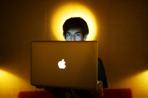 In this Jan. 30, 2009 photo, Internet activist Aaron Swartz poses for a photo in Miami Beach, Fla. Swartz was found dead Friday, Jan. 11, 2013, in his Brooklyn, N.Y., apartment, according to Ellen Borakove, spokeswoman for New York's medical examiner. Swartz, 26, was scheduled to face trial on hacking charges in a few weeks. (AP Photo/The New York Times, Michael Francis McElroy)