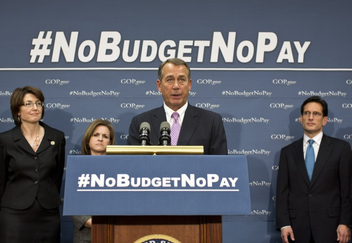 Speaker of the House John Boehner, R-Ohio, and the House GOP leadership speak to reporters after a closed-door meeting on avoiding a potential debt crisis, at the Capitol in Washington, Tuesday, Jan. 22, 2013. (AP Photo/J. Scott Applewhite)