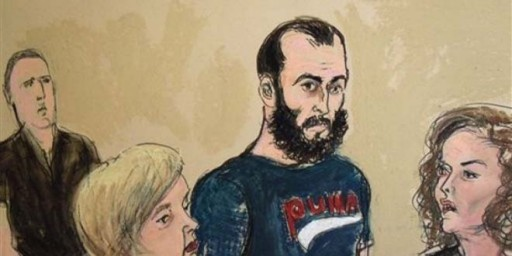 A courtroom sketch of Agron Hasbajrami, center, during his arraignment in September 2011. (AP Photo/Elizabeth Williams)