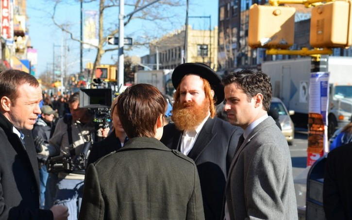 In this Jan, 7 2013, an actor dressed up as a Hasidic Jew talks to the actors portrayed as police investigators. Photo: Eli Wohl