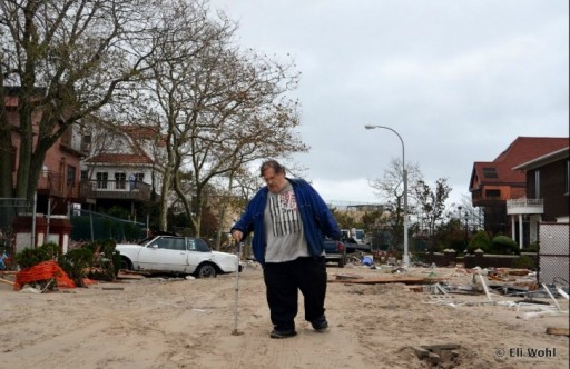 In this Oct. 30 2012 photo, A devastated unidentified long-time resident of Sea Gate walking down the sand-covered Atlantic Avenue while navigating between personal belongings and debris from homes destroyed by Hurricane Sandy. Some of the homes on this water-front street were swept away by the raging waves while all home have suffered extensive damages. Photo: Eli Wohl/VIN News