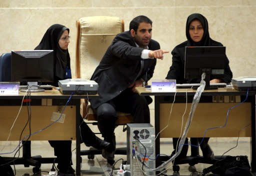 FILE - Personnel staff from the Ministry of Interior look at their computer screen in Teheran, Iran, 05 May 2009.