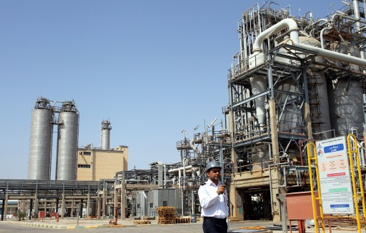 A file photograph showing an Iranian security guard walking in front of the Mahshahr petrochemical complex in Khuzestan province south western Iran. EPA/ABEDIN TAHERKENAREH