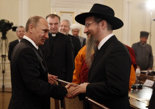 FILE -  Russian Prime Minister Vladimir Putin (L) shakes hands with Russia's Chief Rabbi Berel Lazar (R) during his meeting with religious leaders in the Danilov Monastery in Moscow, Russia, 08 February 2012.  EPA/GRIGORY DUKOR/POOL